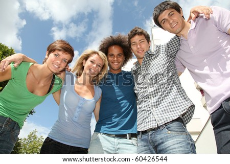 Group of happy students during summer break - stock photo