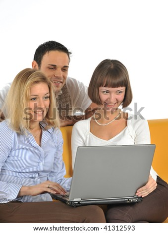 Group of happy students with the laptop isolated