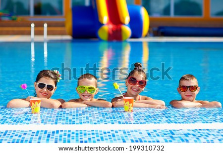 group of happy teenage kids in the pool - stock photo
