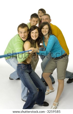 Group of 6 happy teenagers pulling the rope. They're looking at camera. White background.