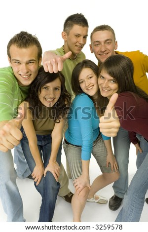 Group of 6 happy teenagers. They're showing thumb up hand sign to the camera. Wide angle. White background.