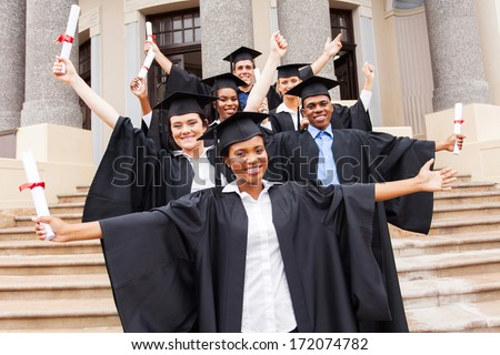 group of happy university students in front of university building - stock photo