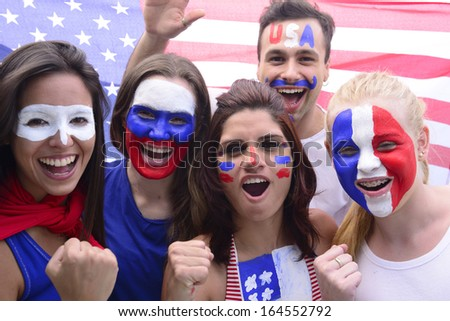 Group of happy USA soccer fans commemorating victory yelling. - stock photo