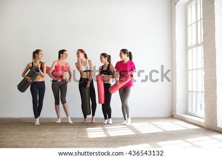 Group of happy women in gym. - stock photo