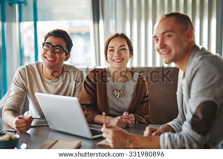 Group of happy young friends or modern business people - stock photo