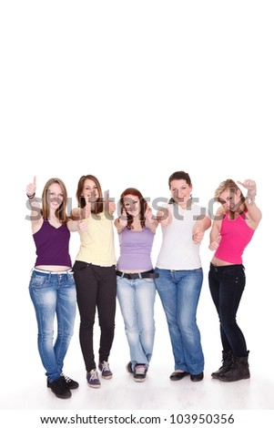 Group of happy young girl giving the thumbs-up sign - stock photo