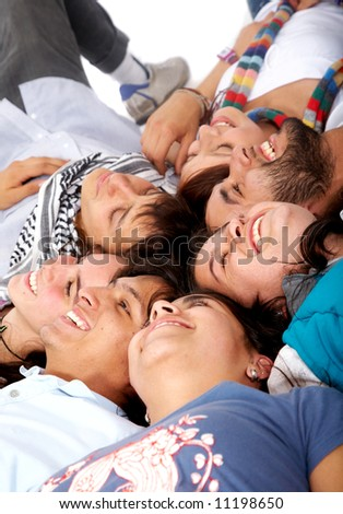 group of happy young people on the floor smiling - stock photo