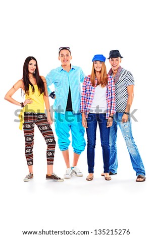 Group of happy young people standing together. Friendship. Isolated over white. - stock photo