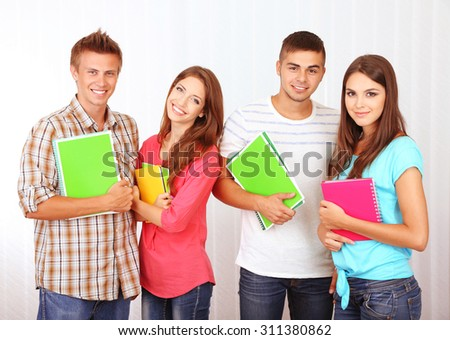 Group of happy young students, indoors