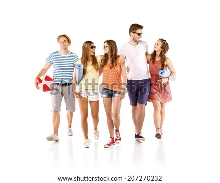 Group of happy young teenager students standing and smiling - stock photo