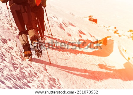 Group of hikers in the mountain. Climb to the top. mountaineering - stock photo