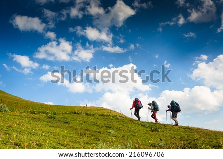 group of hikers in the mountain, travel sport lifestyle concept  - stock photo
