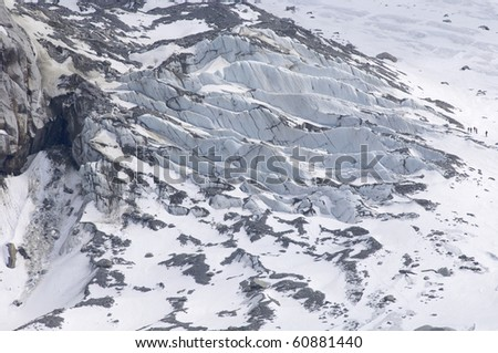 group of hikers on a glacier cracks white valley chamonix, alps, france - stock photo