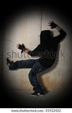 Group of Hiphop dancer posing isolated against a brunge wall - stock photo