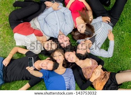 Group of hispanic friends taking a picture - stock photo