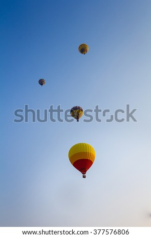 group of hot air balloon floating across the sky - stock photo