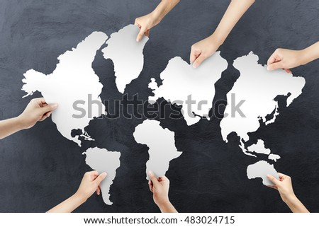 Group human hands holding jigsaw puzzle stock photo royalty free group of human hands holding with jigsaw puzzle forming in world map dark texture background gumiabroncs Gallery