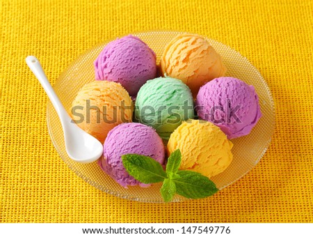 Group of ice cream scoops on a yellow cloth - stock photo