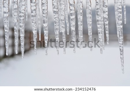 Group of icicles hanging - stock photo