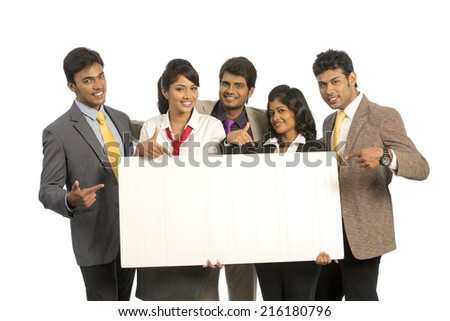 Group of Indian business people with white board on white background.  - stock photo