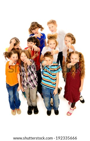 Group of joyful children shows a finger at the camera. Isolated over white. - stock photo