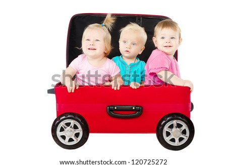 Group of kids driving in suitcase car. Shipping and innovation concept. Isolated white - stock photo