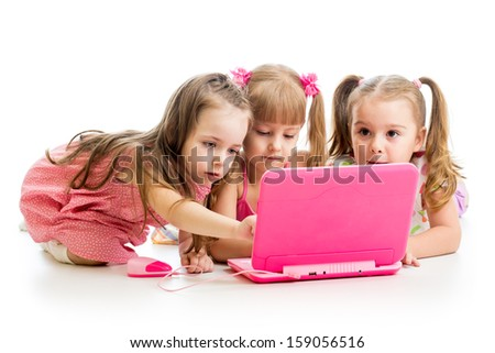 group of kids friends looking at the laptop - stock photo