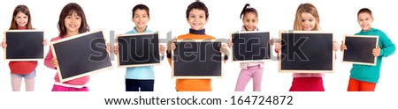 group of kids holding blackboards isolated in white - stock photo
