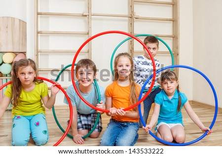 Group of kids holding hula hoops - stock photo