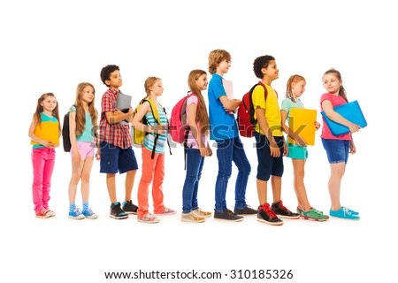Group of kids in a line side view - stock photo