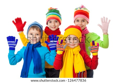 Group of kids in colorful winter clothes, isolated on white - stock photo