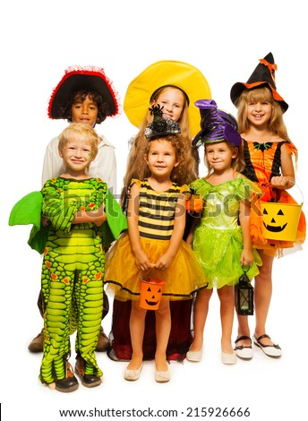 Group of kids in costumes isolated on white - stock photo