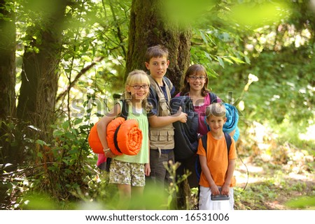 Group of kids outdoors with camping gear - stock photo