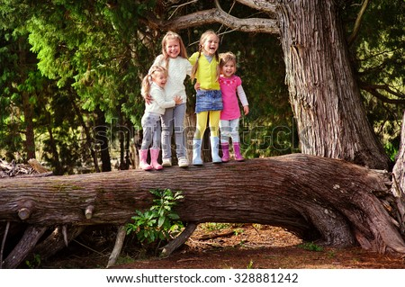 Group of Kids playing on a holidays outside - stock photo