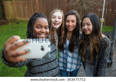 Group of kids taking a selfie - stock photo