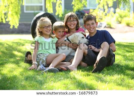 Group of kids wit dog - stock photo