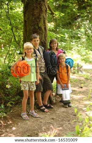 Group of kids with camping gear - stock photo