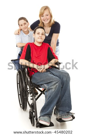 Group of kids with one adolescent boy in a wheelchair.  Full body isolated. - stock photo