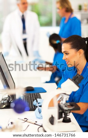 group of lab teachnican working in a modern laboratory - stock photo