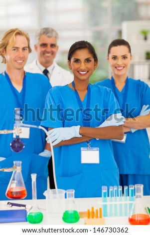 group of lab technicians in modern lab - stock photo