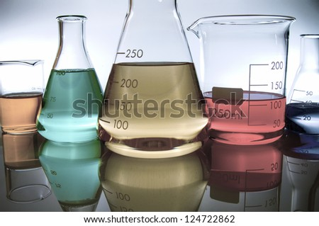 group of laboratory flasks with colored liquid inside - stock photo