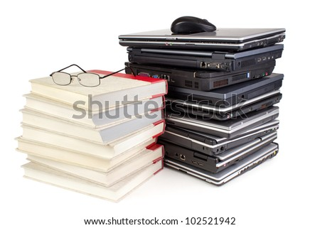 Group of laptops with mouse and books with glasses, white background