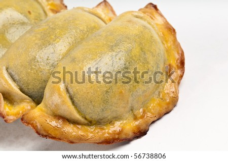 Group of Latin american empanadas. The Empanada is a pastry turnover filled with a variety of savory ingredients and baked or fried. - stock photo