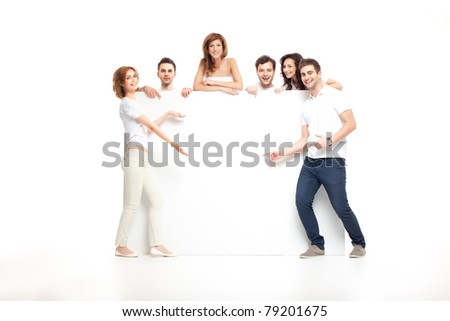 group of laughing friends showing blank banner - stock photo