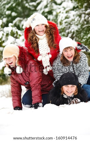 Group of laughing students in a snowy park - stock photo