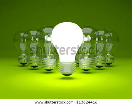 Group of light bulbs on green background - stock photo