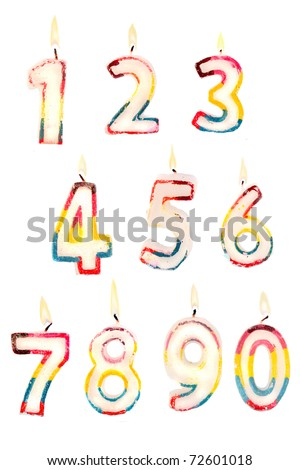 Group of lit birthday candle numbers on a white background for easy editing - stock photo