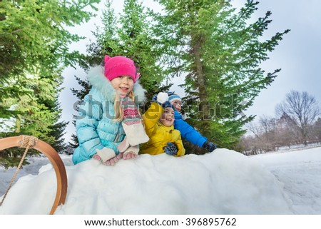 Group of little children play snowball in fortress - stock photo