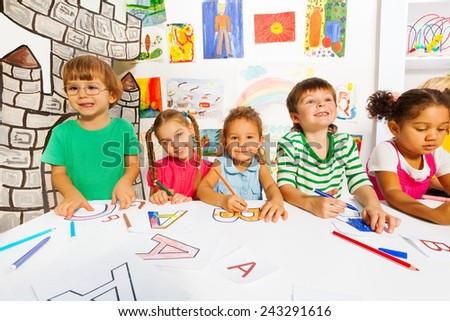 Group of little kids in early development class - stock photo