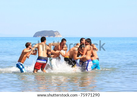 Group of male friends having lots of fun in their vacation in Greece - stock photo